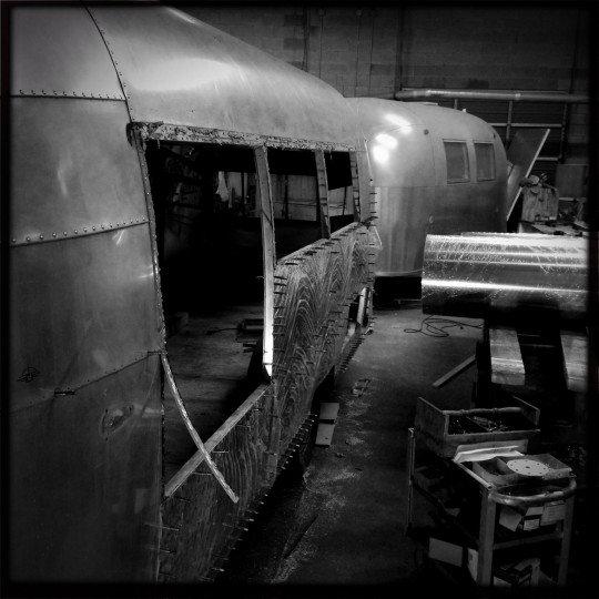 """""""Fred"""" sits near a 1968 Airstream Caravel also being worked on at Frank's Trailer Works. (Christopher T. Assaf/Baltimore Sun)"""
