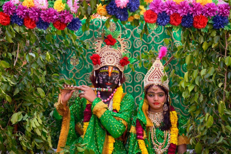 Indian devotees dressed as Hindu deities Krishna (L) and Radha (R) participate in a Hindu religious procession on the occasion of the Ram Navmi festival in Amritsar. Ram Navmi commemorates the birth of Hindu deity Rama. (Narinder Nanu/AFP-Getty Images)