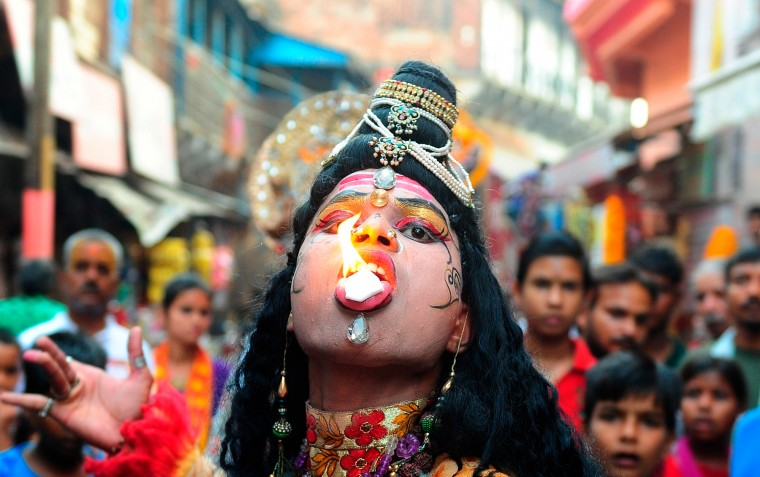 An Indian devotee dressed as the Hindu Lord Shiva participates in a procession to celebrate the Ram Navami festival in Allahabad. Hindu devotees celebrate the festival of Ram Navami, the birth anniversary of Lord Rama, which also marks the end of the nine-day long fasting and Navaratri festival. (Sanjay Kanojia/AFP-Getty Images)