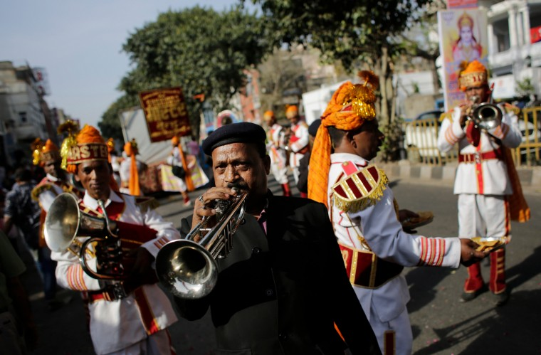 Members of a brass band play religious tunes during in a religious procession on Ram Navami festival in New Delhi, India. Ram Navami marks the birth of Hindu God Rama. (Altaf Qadri/Associated Press)