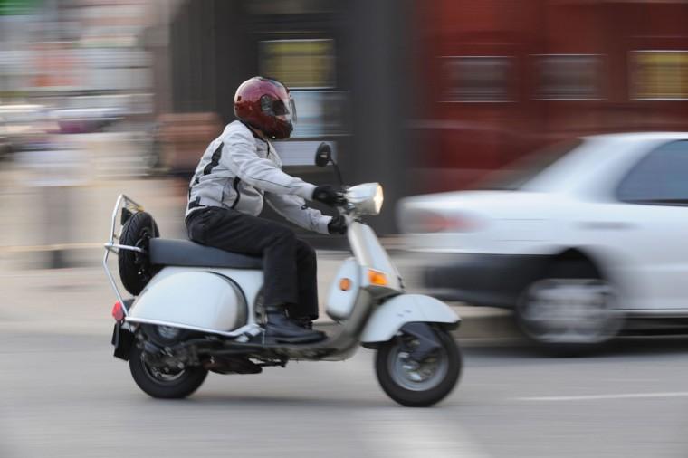 Yep, sometimes we even motor around on scooters, too. (Gene Sweeney Jr./Baltimore Sun)