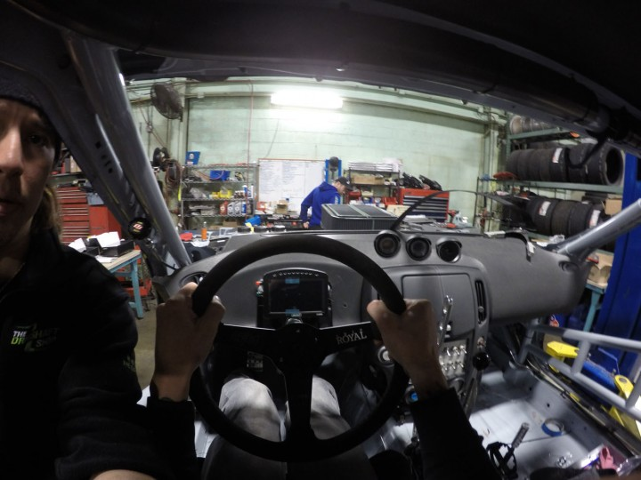 Checking seat and steering wheel position. Everything is adjustable to make sure it is set up just the way I need it to be. That digital dash display reads and records hundreds of inputs to help us set up the car. Everything from RPM, nitrous pressures, and even GPS track mapping. Not to mention Ray leaning in for his closeup as he checks my shoulder straps.