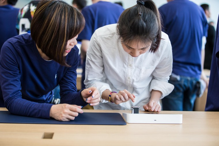 A customer prepares to touch an Apple Watch smartwatch at an Apple Store near West Lake on April 10, 2015 in Hangzhou, Zhejiang province of China. (ChinaFotoPress/Getty Images)