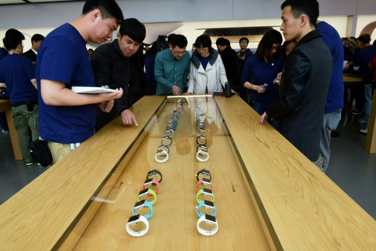 Customers look at Apple Inc. Apple Watch smartwatches displayed at an Apple Store near West Lake on April 10, 2015 in Hangzhou, Zhejiang province of China. Apple's first new gadget under Chief Executive Officer Tim Cook is debuting in eight countries and Hong Kong for previews, with shipments scheduled to start April 24. (ChinaFotoPress/Getty Images)