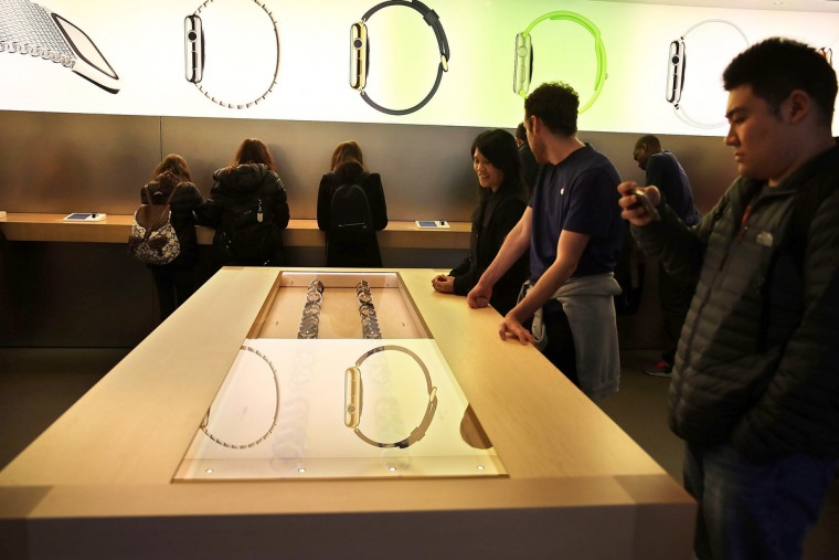 People look at the new Apple Watch at an Apple store in Manhattan on April 10, 2015 in New York, New York. Consumers around the world were able to try on the long awaited smartwatch on Friday and to place orders. (Spencer Platt/Getty Images)
