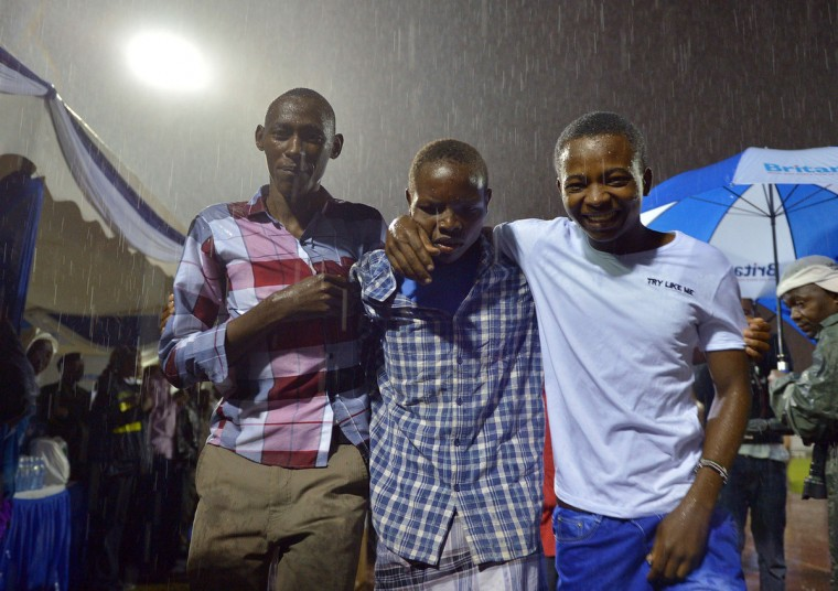 A survivor (center) is reunited with relatives in Nairobi on April 4, 2015, after an attack by islamist gunmen claimed by al-Shabab on a university campus in Garissa, northern Kenya. Kenya's President, Uhuru Kenyatta vowed Saturday, to retaliate in the severest way against Somalia's al-Shabab islamists after they massacred nearly 150 people at a university. Tony Karumba/AFP Getty Images