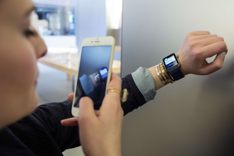 A French customer uses an iPhone 6 smartphone to take a photo of an Apple Watch, during the device presentation at an Apple store in Lyon, central-eastern France, A French customer uses an iPhone 6 smartphone to take a photo of an Apple Watch, during the device presentation at an Apple store in Lyon, central-eastern France, on April 10, 2015. (Philipe Merle/AFP/Getty Images)