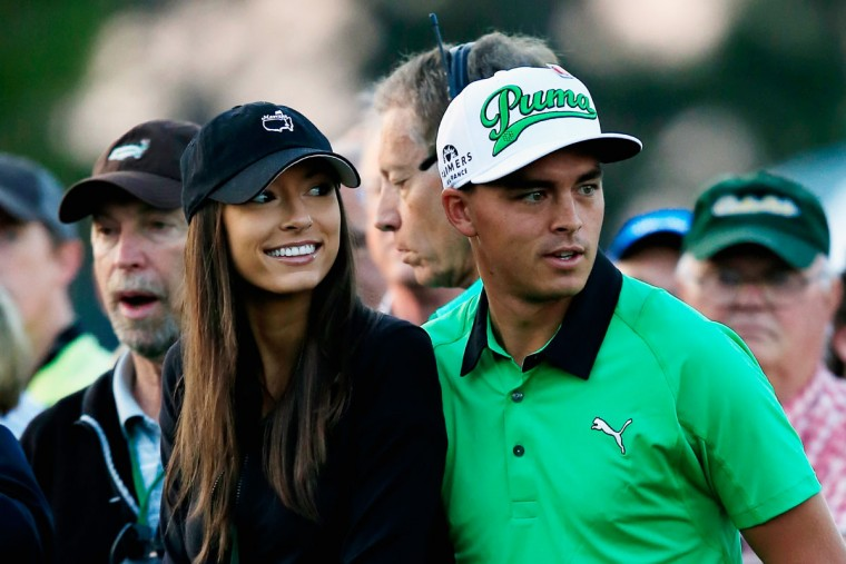 Rickie Fowler of the United States waits with his girlfriend Alexis Randock near the first tee during the first round of the 2015 Masters Tournament at Augusta National Golf Club on April 9, 2015 in Augusta, Georgia. (Photo by Jamie Squire/Getty Images)