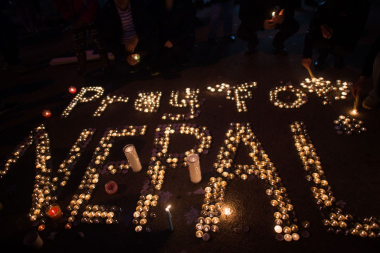 Hundreds of people gather in Diversity Square to light candles during a vigil for the victims of the earthquake in Nepal on April 26, 2015 in the Jackson Heights section of the Queens borough of New York City. A major 7.8 earthquake hit Kathmandu mid-day on Saturday, and was followed by multiple aftershocks that triggered avalanches on Mt. Everest that buried mountain climbers in their base camps. Many houses, buildings and temples in the capital were destroyed during the earthquake, leaving thousands dead or trapped under the debris as emergency rescue workers attempt to clear debris and find survivors. (Photo by Andrew Theodorakis/Getty Images)