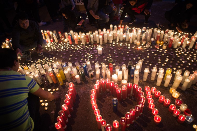 Hundreds of people gather in Diversity Square to light candles during a vigil for the victims of the earthquake in Nepal on April 26, 2015 in the Jackson Heights section of the Queens borough of New York City. A major 7.8 earthquake hit Kathmandu mid-day on Saturday, and was followed by multiple aftershocks that triggered avalanches on Mt. Everest that buried mountain climbers in their base camps. Many houses, buildings and temples in the capital were destroyed during the earthquake, leaving thousands dead or trapped under the debris as emergency rescue workers attempt to clear debris and find survivors. (Photo by Andrew Theodorakis/Getty Images).