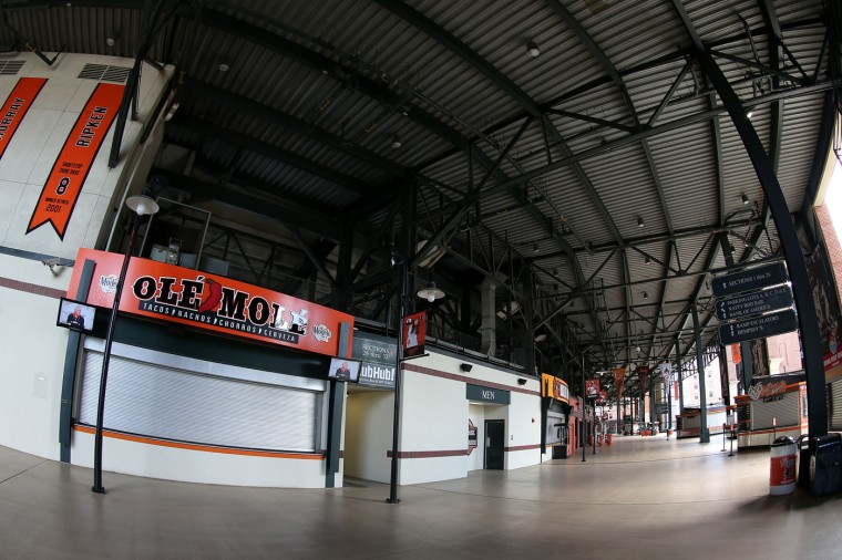 The main concourse is seen empty before the Baltimore Orioles play the Chicago White Sox at Oriole Park at Camden Yards on April 29, 2015 in Baltimore, Maryland. Due to unrest in relation to the arrest and death of Freddie Gray, the two teams played in a stadium closed to the public. Gray, 25, was arrested for possessing a switch blade knife April 12 outside the Gilmor Houses housing project on Baltimore's west side. According to his attorney, Gray died a week later in the hospital from a severe spinal cord injury he received while in police custody. (Photo by Patrick Smith/Getty Images)