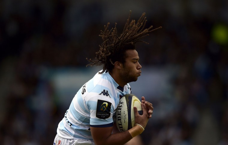 Racing-Metro's left wing Teddy Thomas jumps for the ball during the European Champions Cup rugby union match Racing Metro 92 vs Saracens, on April 5, 2015, at the Yves-du-Manoir Stadium in Colombes, outside Paris. (AFP Photo/Franck Fife)