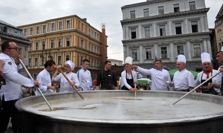 Bosnian chefs attempt to make the world's largest batch of chicken soup in Sarajevo on April 17, 2015. Chefs hope to enter the Guinness Book of Records by cooking 4,124 kilograms of Bosnia's traditional Bey's soup. After the stew was ready it was shared with citizens gathered to observe this record-breaking venture.  || CREDIT: ELVIS BARUKCIC - AFP/GETTY IMAGES