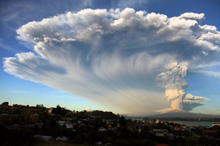 View from Puerto Montt, southern Chile, of a high column of ash and lava spewing from the Calbuco volcano, on April 22, 2015. Chile's Calbuco volcano erupted on Wednesday, spewing a giant funnel of ash high into the sky near the southern port city of Puerto Montt and triggering a red alert. Authorities ordered an evacuation for a 10-kilometer (six-mile) radius around the volcano, which is the second in southern Chile to have a substantial eruption since March 3, when the Villarrica volcano emitted a brief but fiery burst of ash and lava. (AFP Photo/P /aton )