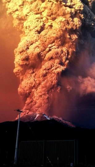 View from Puerto Varas, southern Chile, of a high column of ash and lava spewing from the Calbuco volcano, on April 22, 2015. Chile's Calbuco volcano erupted on Wednesday, spewing a giant funnel of ash high into the sky near the southern port city of Puerto Montt and triggering a red alert. Authorities ordered an evacuation for a 10-kilometer (six-mile) radius around the volcano, which is the second in southern Chile to have a substantial eruption since March 3, when the Villarrica volcano emitted a brief but fiery burst of ash and lava. (AFP Photo/P /strstr/afp/getty )