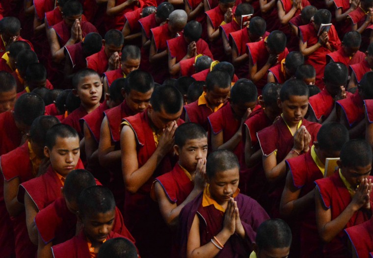 Nepalese novice Buddhist monks living at the Bodhgaya Tergar monastary offer prayers for the victims of an earthquake in Nepal at the Bodhgaya Mahabodhi temple in the Indian town of Bodhgaya on April 26, 2015. Powerful aftershocks rocked Nepal April 26, 2015, panicking survivors of a quake that killed more than 2,300 and triggering fresh avalanches at Everest base camp, as rescuers dug through rubble in the devastated capital Kathmandu. Terrified residents, many forced to camp out in the capital after the April 25, 2015, quake reduced buildings to rubble, were jolted by a 6.7-magnitude aftershock that compounded the worst disaster to hit the impoverished Himalayan nation in more than 80 years. (AFP Photo/Strstrdel/afp/getty Images )