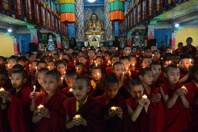 Nepalese novice Buddhist monks who live at the Tergar monastery in the Indian town of Bodhgaya on April 26, 2015 offer prayers for the victims of an earthquake in Nepal. Powerful aftershocks rocked Nepal April 26, panicking survivors of a quake that killed more than 2,300 and triggering fresh avalanches at Everest base camp, as rescuers dug through rubble in the devastated capital Kathmandu. (AFP Photo/P /afp/getty )