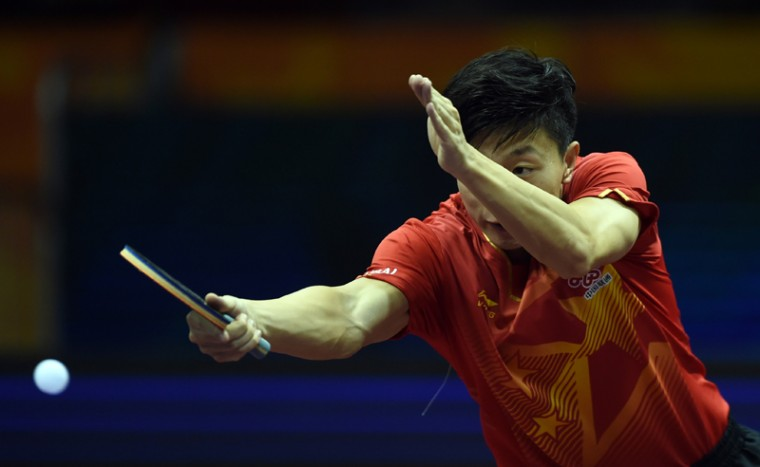 Ma Long of China returns a ball during his men's single match against Noshad Alamiyan of Iran at the 2015 World Table Tennis Championships at the Suzhou International Expo Center in Suzhou, Jiangsu province on Tuesday. (JOHANNES EISELE/AFP/Getty Images)