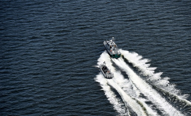 Boats of the Finnish border guard patrol in the waters off the coast near Helsinki on Tuesday. Finland said taht its navy had fired warning shots at a possible submarine off the coast of Helsinki early Tuesday. (JUSSI NUKARI/AFP/Getty Images)