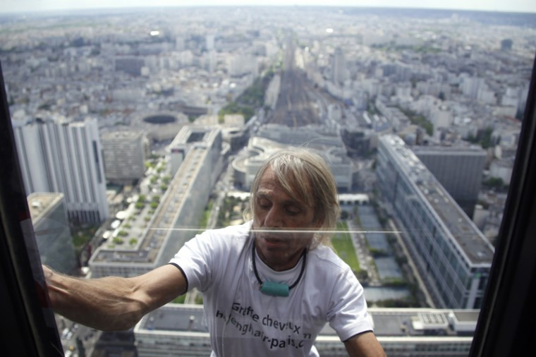 Alain Robert, the French urban climber dubbed Spiderman, climbs the Tour Montparnasse skyscraper on Tuesday in Paris. (KENZO TRIBOUILLARD/AFP/Getty Images)