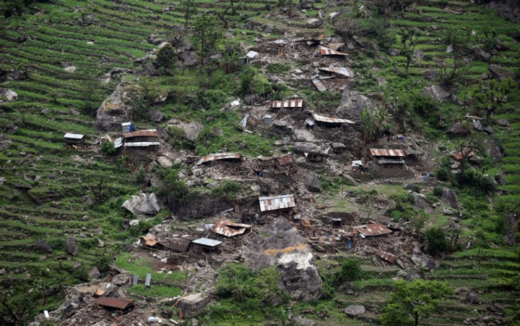 Damaged houses are seen from an Indian Army helicopter following an earthquake in the Nepalese area of Gorkha on Tuesday. Nepalese villagers rushed toward a relief helicopter begging to be airlifted to safety after a huge earthquake that has killed at least 4,349 people (SAJJAD HUSSAIN/AFP/Getty Images)