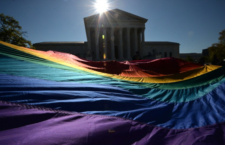 Supporters of same-sex marriages gather outside the U.S. Supreme Court waiting for its decision on Tuesday in Washington. The court is hearing arguments on whether gay couples have a constitutional right to wed -- a potentially historic decision that could see same-sex marriage recognized nationwide.  (MLADEN ANTONOVMLADEN ANTONOV/AFP/Getty Images)