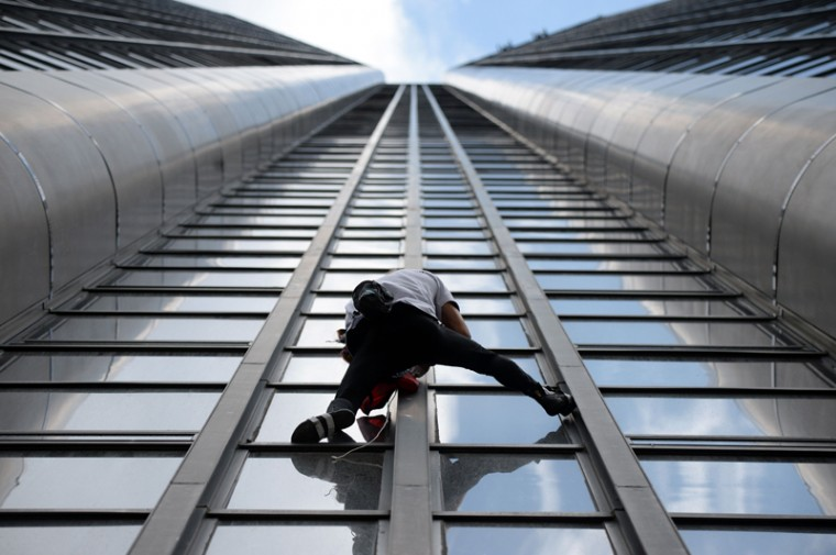 Alain Robert, the French urban climber dubbed Spiderman, climbs the 689-foot Tour Montparnasse skyscraper on Tuesday in Paris. (STEPHANE DE SAKUTIN/AFP/Getty Images)