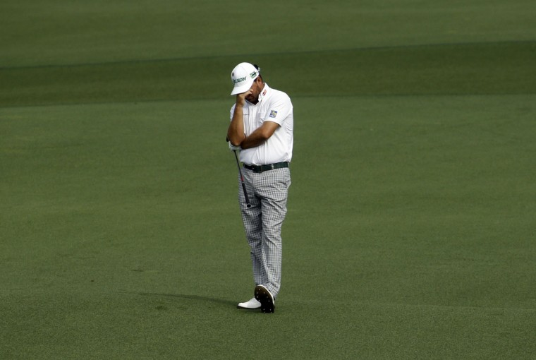 Graeme McDowell, of Northern Ireland, reacts after his approach shot to the second green during the second round of the Masters golf tournament Friday, April 10, 2015, in Augusta, Ga. (AP Photo/Darron Cummings)