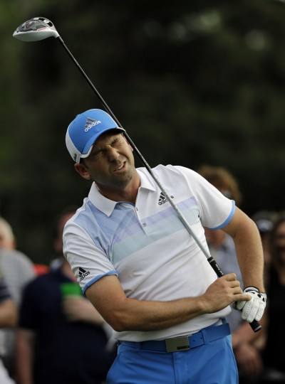Sergio Garcia, of Spain, reacts to his tee shot on the 18th hole during the first round of the Masters golf tournament Thursday, April 9, 2015, in Augusta, Ga. (AP Photo/David J. Phillip)
