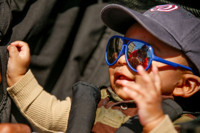 Cole Reaves of Alexandria, Va., smiles as he arrives before a baseball game between the Washington Nationals and the New York Mets on opening day at Nationals Park, Monday, April 6, 2015, in Washington. (AP Photo/Andrew Harnik)