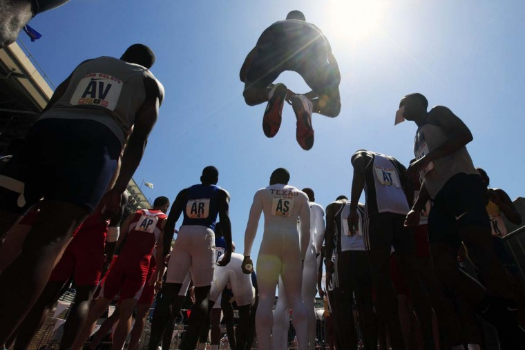 2010 caption:  Competitors warm up in the paddock as they prepare to run in the Penn Relays athletics meet in Philadelphia, Friday, April 23, 2010.  || CREDIT: MATT ROURKE - AP PHOTO