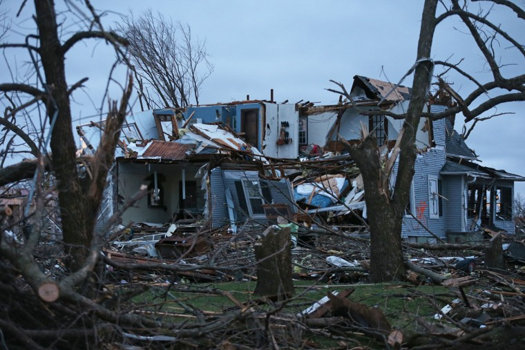 A house is destroyed after a late night tornado passed through the area, Friday, April 10, 2015 in Fairdale, Ill. The National Weather Service says at least two tornadoes churned through six north-central Illinois counties. (AP Photo/Chicago Tribune, John J. Kim)