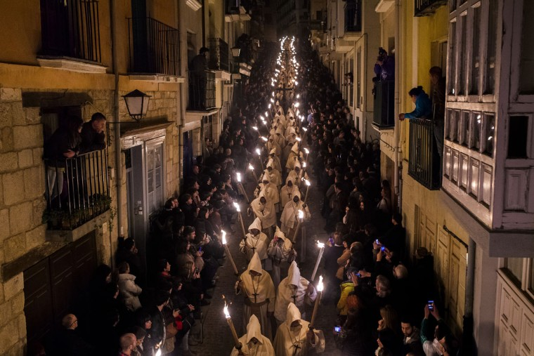 Penitents from 'Cristo de la Buena Muerte' or 'Good Dead Christ' brotherhood take part in a procession in Zamora, Spain, early Tuesday, March 31, 2015. Hundreds of processions take place throughout Spain during the Easter Holy Week. (AP Photo/Andres Kudacki)