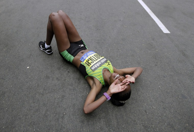 Caroline Rotich, of Kenya, reacts after winning the women's division of the Boston Marathon Monday, April 20, 2015 in Boston. AP Photo/Elise Amendola)