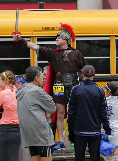 Boston Marathon runner Alberto De Bonis, of Trieste, Italy, poses before boarding a shuttle bus, Monday, April 20, 2015, in Boston, en route to the starting line in Hopkinton, Mass. (AP Photo/Robert F. Bukaty)