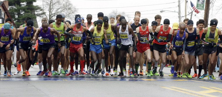 Men's elite runners leave the start line of the Boston Marathon Monday, April 20, 2015 in Hopkinton, Mass. (AP Photo/Stephan Savoia)