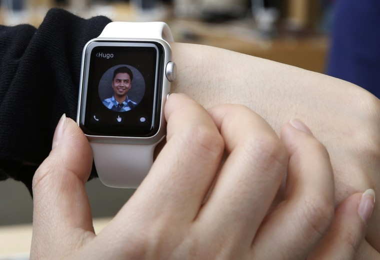A customer tries on an Apple Watch at an Apple Store in Hong Kong Friday, April 10, 2015. From Beijing to Paris to San Francisco, the Apple Watch made its debut Friday. Customers were invited to try them on in stores and order them online. (Kin Cheung/AP photo)