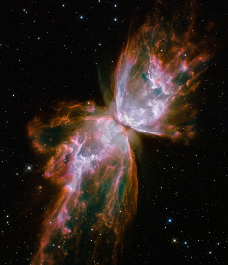 "This Hubble image shows jets of gas heated to nearly 20,000 degrees Celsius traveling at more than 59,000 miles per hour streaming from the dying star NGC 6302, the ""Butterfly Nebula"" in the Milky Way galaxy. (NASA/ESA/Hubble SM4 ERO Team via AP)"