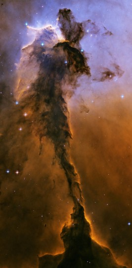This Hubble image shows a tower of cold gas and dust rising from the Eagle Nebula. (NASA, ESA, Hubble Heritage Team via AP)