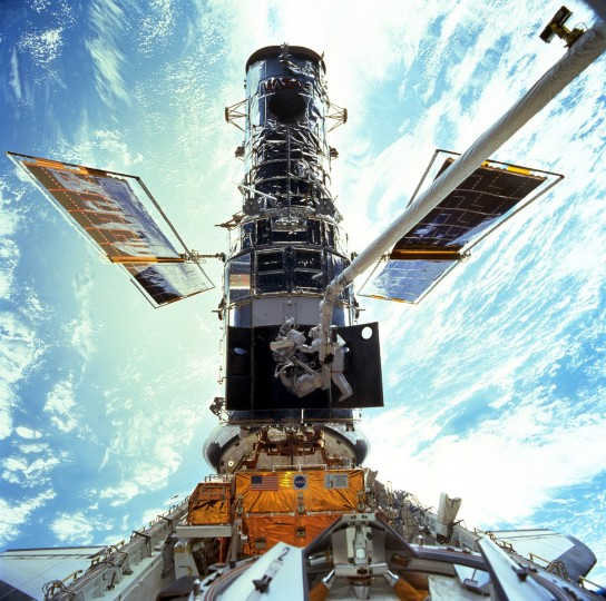 Astronauts Steven L. Smith and John M. Grunsfeld are photographed during an extravehicular activity in the December 1999 Hubble servicing mission of STS-103, flown by Discovery. (NASA/JSC via AP)
