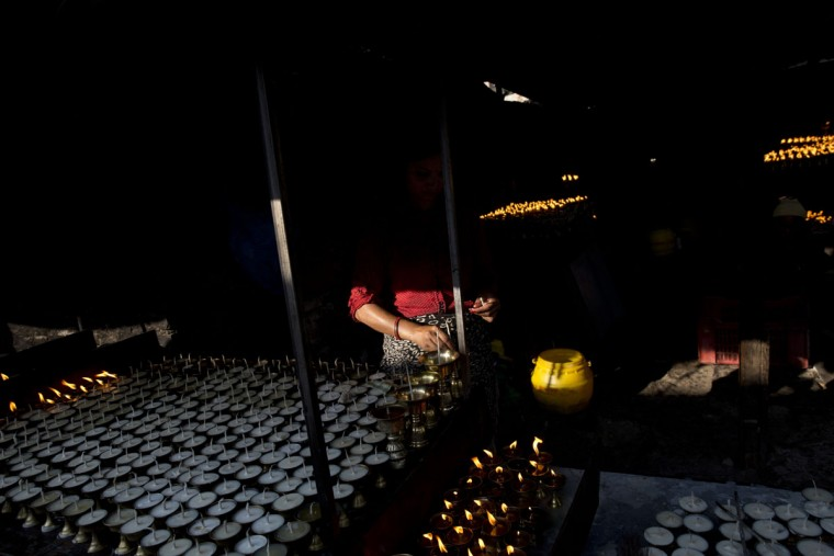 Butter lamp for prayers are displayed for sale near the Boudhanath Stupa two days after the earthquake in Kathmandu, Nepal, Monday, April 27, 2015. Locals say more people than usual are arriving here to offer prayers for the earthquake victims. The earthquake was the worst to hit the South Asian nation in more than 80 years. (AP Photo/Bernat Armangue)