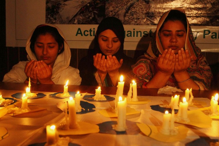 Pakistani girls light candles and offer prayers for Nepalese victims of Saturday's earthquake, in Multan, Pakistan, Monday, April 27, 2015. The earthquake was the worst to hit the South Asian nation in more than 80 years. It was strong enough to be felt all across parts of India, Bangladesh, China's region of Tibet and Pakistan. (AP Photo/Asim Tanveer)