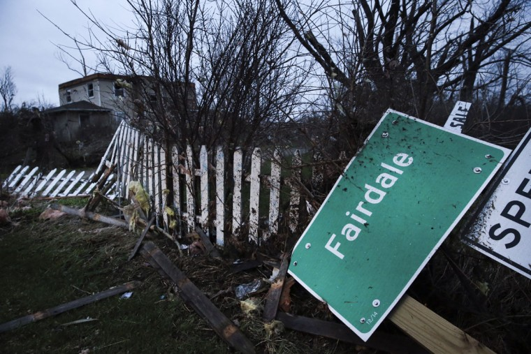 A Fairdale sign is torn from the ground after a tornado passed through the area, Friday, April 10, 2015 in Fairdale, Ill. The National Weather Service says at least two tornadoes churned through six north-central Illinois counties. (AP Photo/Chicago Tribune, Armando L. Sanchez)