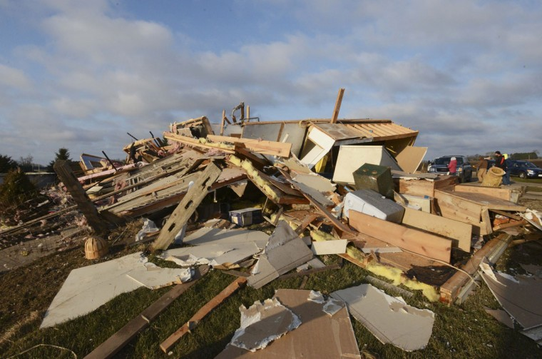A home is seen destroyed in Rochelle, Ill., Friday morning, April 10, 2015, after a tornado swept through the area Thursday evening. The National Weather Service says at least two tornadoes churned through six north-central Illinois counties. One person was killed in the small town of Fairdale, Ill. (AP Photo/Daily Herald, Paul Michna)