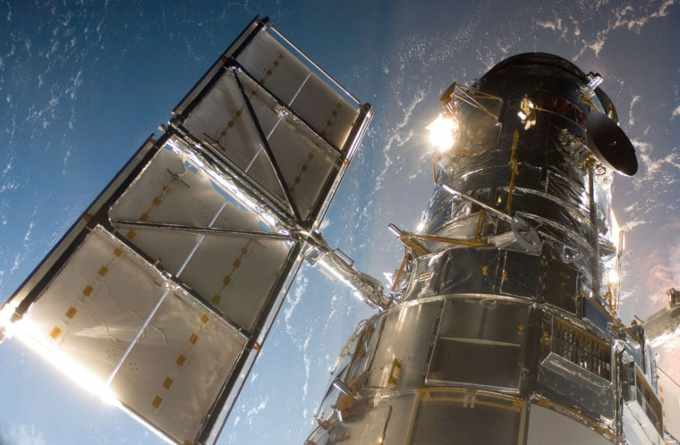 The Hubble Space Telescope following the grapple of the observatory by the shuttle's remote manipulator system (2009 AP Photo/NASA)