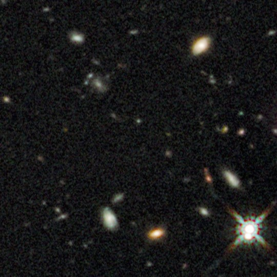 This undated handout image taken by the Hubble Space Telescope shows a small smudge, center, that astronomers believe is the oldest thing they have ever seen. (AP Photo/NASA)