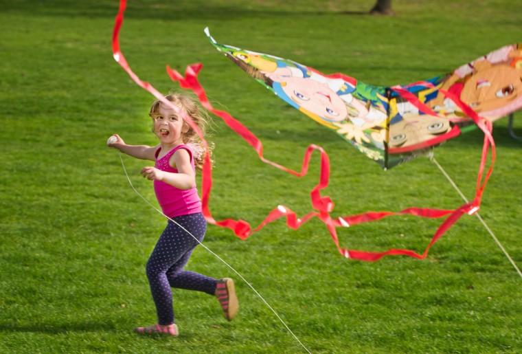 Ella Noack, 4, runs while flying a kite on Tuesday, April 7, 2015 in Walla Walla, Wash. (AP Photo/Walla Walla Union-Bulletin, Greg Lehman)