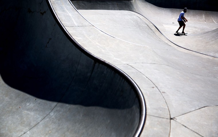 A skateboarder rides through a bowl at a skate park, Tuesday, April 21, 2015, in Atlanta. (AP Photo/David Goldman)