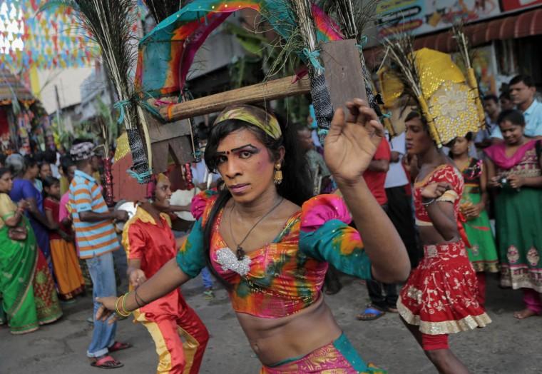 A Sri Lankan ethnic Tamil dancer performs during an annual Hindu temple procession in Colombo, Sri Lanka, Friday, April 24, 2015. (AP Photo/Eranga Jayawardena)