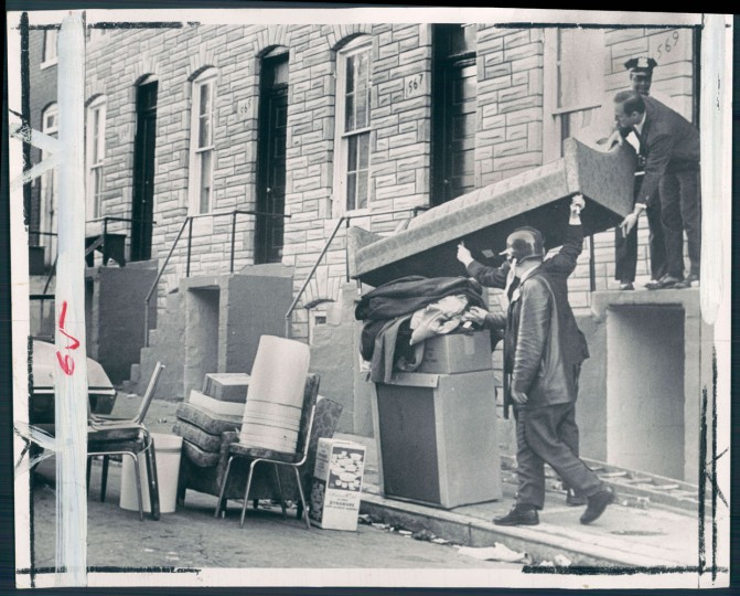 These aren't looters. They're Baltimore policemen recovering loot from a vacant house in the 1500 Block of Richland street. A patrol removed a cache of furniture.